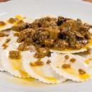 Vegan mezzelune with mushroom sauce